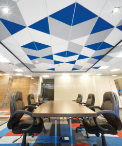 A combination of different coloured triangles and parallelograms add life to the boardroom.