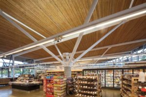 View of the tubular steel tree column in Askew's Uptown Supermarket. Photo © Derek Lepper Photography. Photo courtesy Allen+Maurer Architects Ltd.