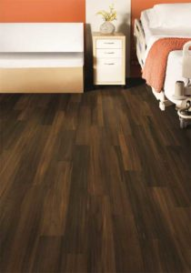 The realistic visuals and textures of today's vinyl sheet flooring can bring the look of natural wood and create a 'home-like' atmosphere in health care settings.