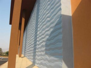 Metallic effect over continuously insulated exterior wall system.
