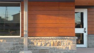The Collingwood Firehall in Ontario features a wood veneer façade used with rivets whereby one of four exposed fasteners are fixed and the other three are floating points to allow for the coefficient of expansion and contraction. Project team includes MCL Architects and GRC Contracting.