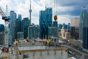 The 100 Queens Quay East office tower, Toronto, reaches completion of its exterior structure. Photo courtesy CNW Group/Menkes Developments Ltd