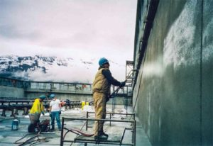 A protective layer of crystalline waterproofing is applied to the Valdez Marine Terminal water purifying tanks in Prince William Sound, Alaska.