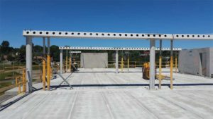 Slim floor structure, composite columns, and required bracing and shoring can be seen in this image.