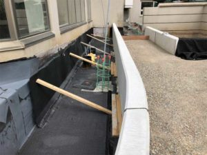 Cross-sectional view of overburden installed on a podium deck at a condominium located at 30 Greenfield Avenue in Toronto.