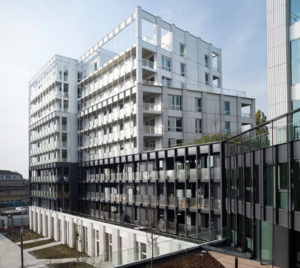 Codefy's mixed-used project in Lille, France offers a duality between the bold urban façades and the centre of the block.